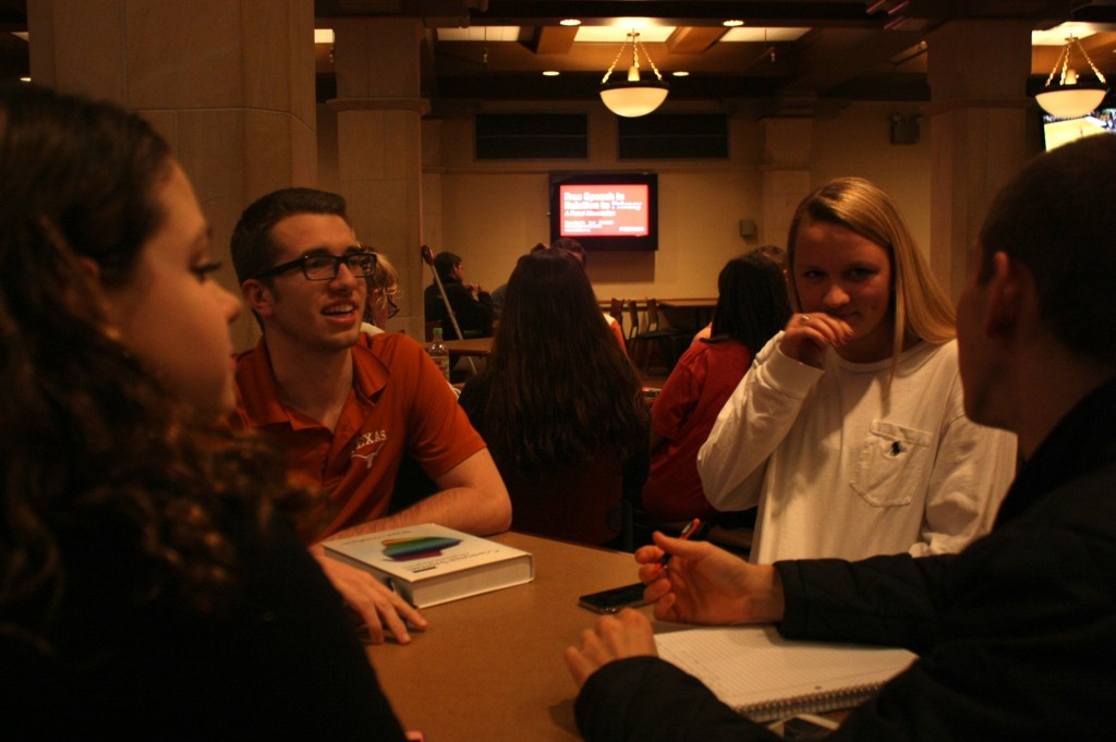 Team members Courtney Ross, Jeremy Hintz, Courtney Bohrer and Adam Beard find a spot in the Union for a quick meeting.