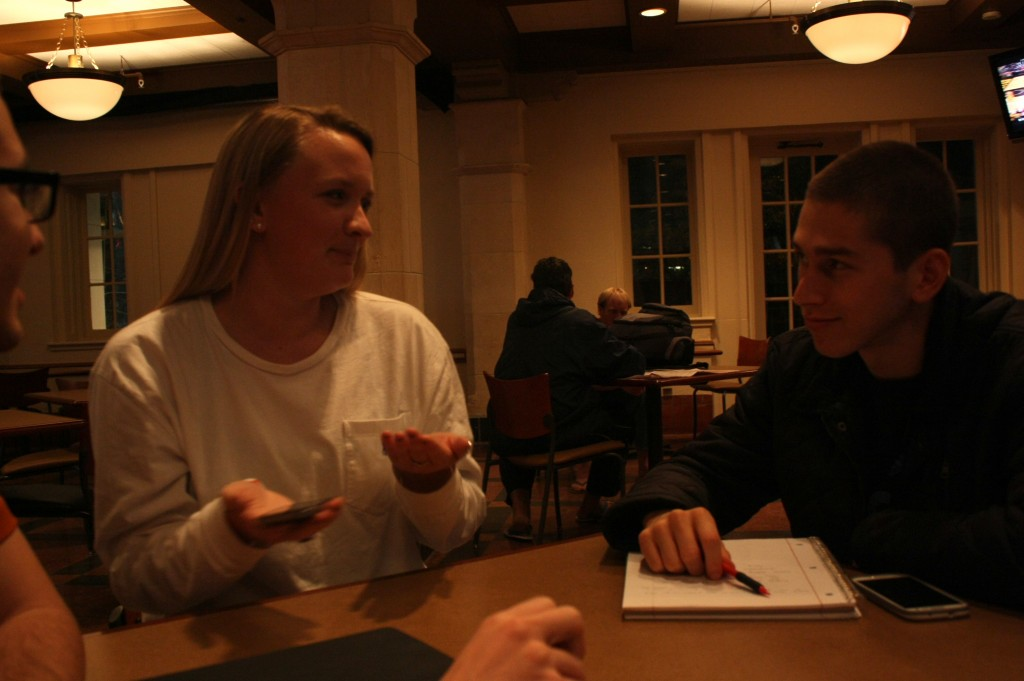 Team members Courtney Bohrer and Adam Beard discuss idea for our first video.